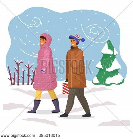 Woman In Pink Down Jacket With Hood, Man In Warm Jacket, Hat, With Paper Gift Bag. Winter Time, Bliz