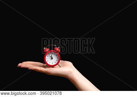 Time Management. Deadline Reminder. Hurry Up. Female Hand Holding Vintage Miniature Red Alarm Clock
