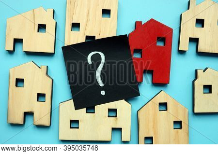 Tiny Houses And Question Mark. Home Valuation And Selection.