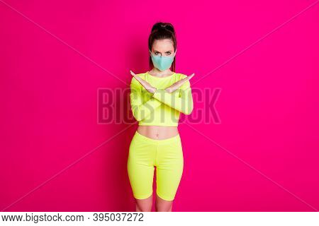 Photo Portrait Of Woman Wearing Medical Mask With Crossed Hands Showing Prevention Sign Isolated On