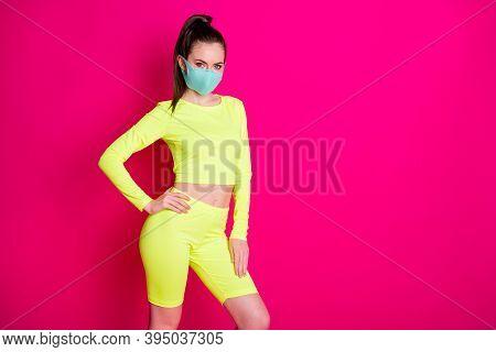 Photo Portrait Of Pretty Sportswoman Wearing Yellow Sportswear Mask Ponytail Isolated On Vivid Fuchs