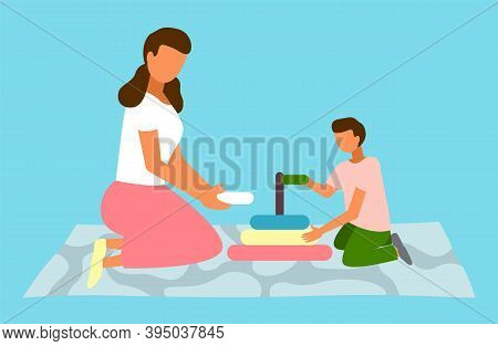 Boy And Mom Playing With Pyramid Toy Vector Flat Illustration. Kid With Mother Stack A Pyramid Of Co