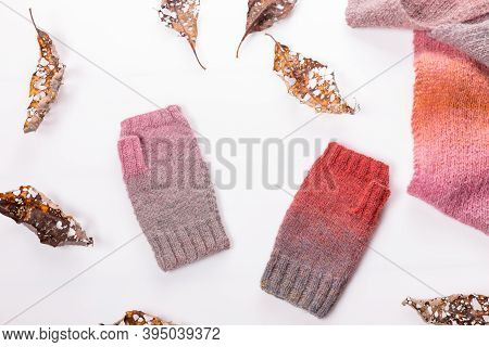 Woolen Knitted Shawl And Gray And Pink Woolen Mitts On A White Background.