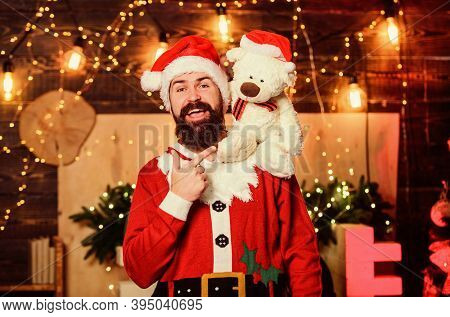 Man Bearded Santa Claus Play With Soft Toy Teddy Bear. Christmas Charity. Celebrate New Year. Winter