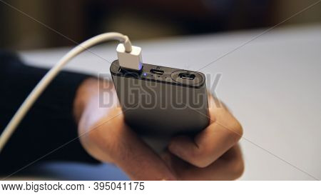 Close Up Of Hand Inserting A Usb Cable Charger Into Portable Power Bank. Media. Close Up Of Mans Han