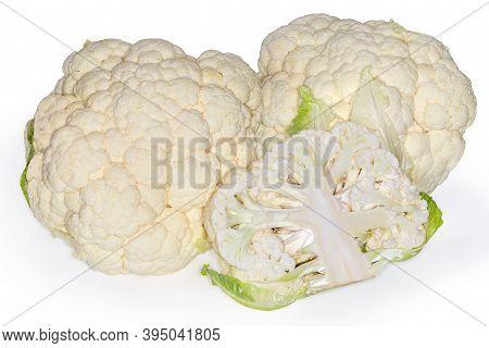 Half Of Fresh Cauliflower Head Against The Two Whole Heads Cauliflower On A White Background