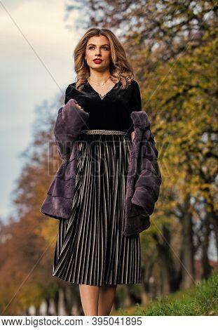 Elegant Girl Walk In Autumn Park. Beauty And Fashion. Woman Wear Fur Coat. Trendy Winter Look. No Co