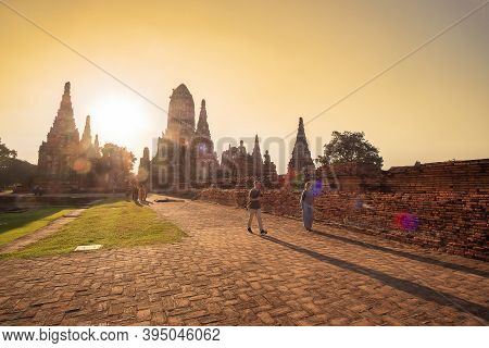 Beautiful Sunset Ancient Stupa In Wat Chaiwatthanaram Temple In Ayutthaya Historical Park, A Unesco