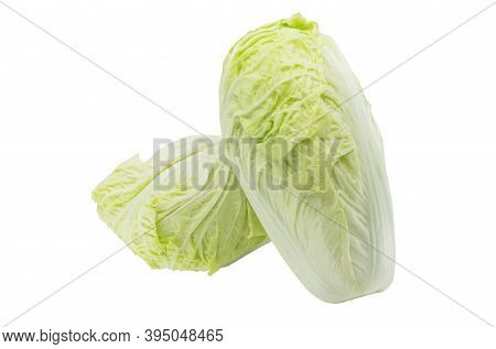 Isolated Two Fresh Organic Chinese Cabbages On White Background. One Chinese Cabbage Is Leaned On Th