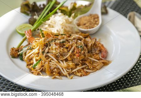 Pad Thai Or Thai Traditional Stir-fried Noodle With Shrimps, Close Up Juicy Pad Thai On White Dish,