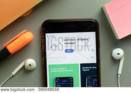 New York, United States - 7 November 2020: Divtimer Dividend Manager App Store Logo On Phone Screen,