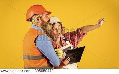 Couple Look Documents. Couple Planning Changes Renovation Apartment. Control Process. Renovation Con