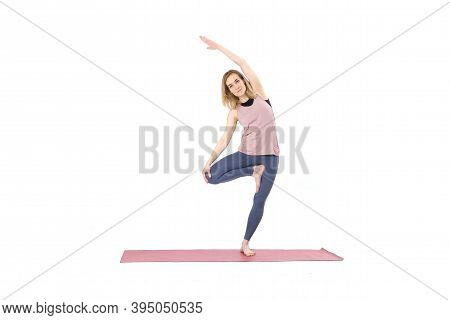 Middle Aged Woman Yoga Asanas. Instructor Shows A Pose From Yoga Isolated On A White Background. Wom