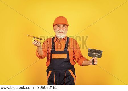 Work For Real Men. Plastering Tools For Plaster. Plaster Trowel Spatula On Yellow Drywall Plasterboa