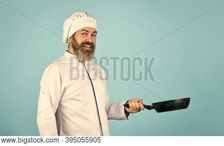 Professional Chef. Husband In Chef Hat On Kitchen. Cooking Food Concept. Hold Frying Pan. Best Quali