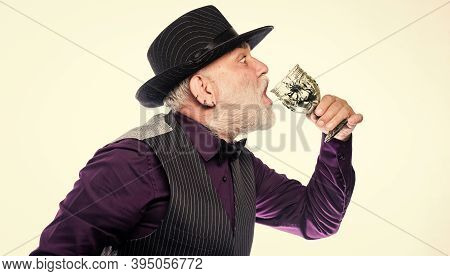 Delicious Cocktail For Brave Man. Bearded Old Guy Hold Wineglass With Spider Inside. Extreme Lifesty