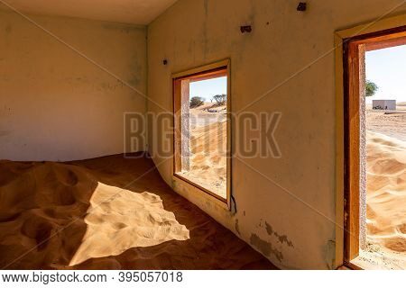 Neglected House Interior Buried In The Sand In Al Madam Ghost Village In United Arab Emirates.