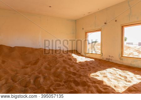 Neglected House Interior Buried In Sand In Village Al Madam In United Arab Emirates.