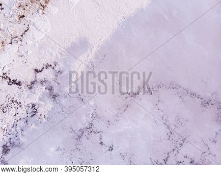 Amazing Forms Of Land Surface Made Of Water And Salt, Nature Abstract Background, Aerial View. Pink