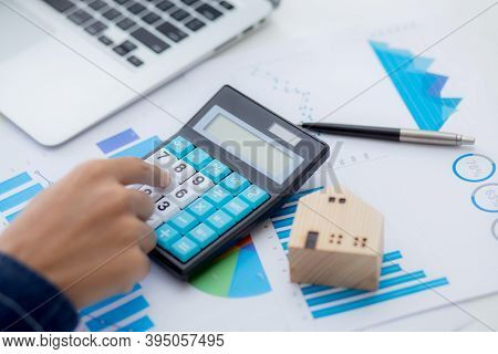 Hand Of Business Man Agent Calculating Loan Of Finance And Investment For Real Estate, Businessman A