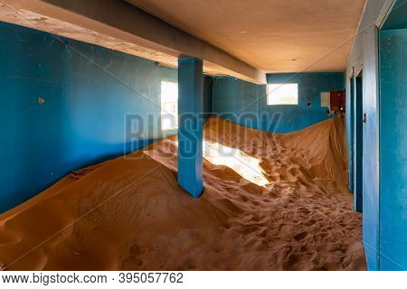 Neglected House Interior With Blue Walls Buried In The Sand In Al Madam Ghost Village In United Arab