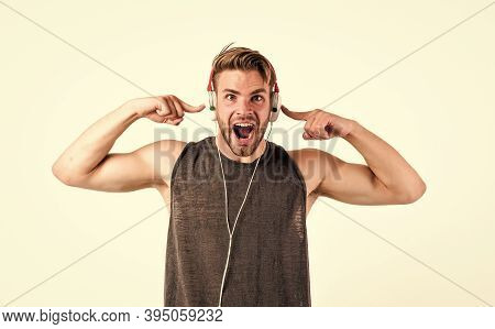 Shouting Guy Listening To Music In Stereo Headset. Mp3 Player. Sexy Muscular Man Listen Music On Pho