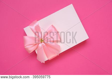 Postcard Blank. Holiday Greeting Card With Pink Bow On Pink Background.birthday Blank Postcard.women