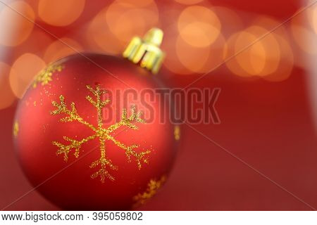 Christmas And New Years Festive Background.red Christmas Ball With Golden Snowflake On Red Backgroun