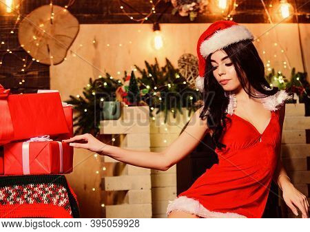 Sex Shop. Attractive Girl In Erotic Lingerie Hold Gift Box. Desirable Santa Girl. Gift For Adults. W