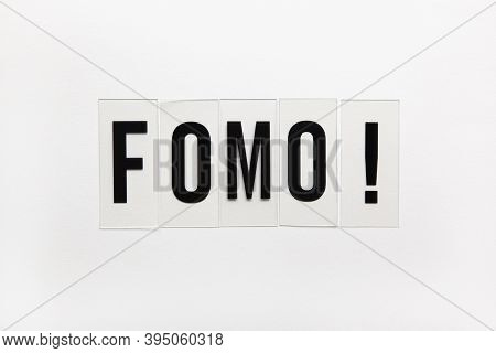 Abbreviation Word Fomo On Transparent Plastic On White. It Means Fear Of Missing Out, Non-stop Inter
