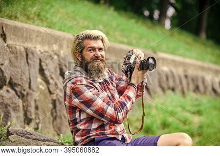 Content Creator. Man Bearded Hipster Photographer Hold Vintage Camera. Photographer Amateur Photogra
