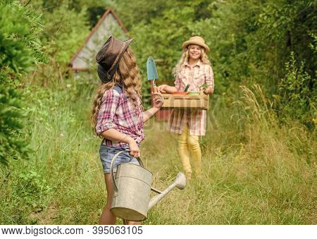 Loving Nature. Girls With Gardening Tools. Child Friendly Garden Tools Ensure Safety Of Child Garden