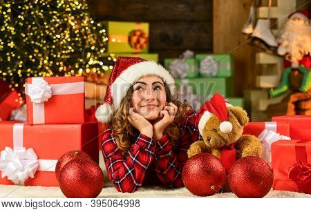 Happy Girl At Christmas Tree. Woman Enjoy Festive Mood. Making Wish. Dreaming About Future Year. Hap