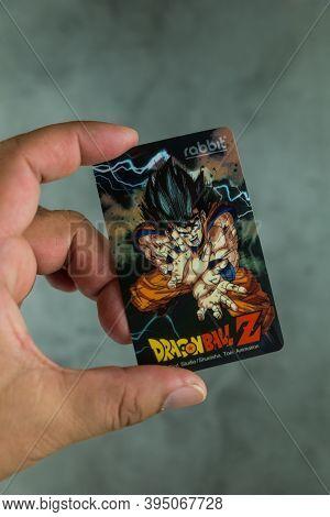 Bangkok, Thailand - November 16, 2020 : Hand Holding Bts Ticket Pattern Dragon Ball Z Collection Sta