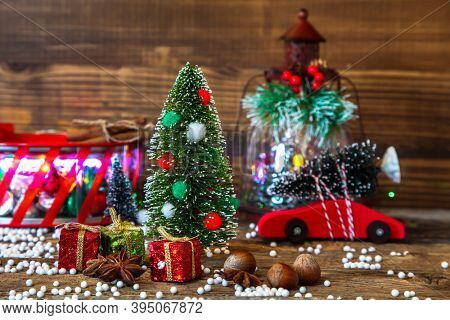 Christmas tree decor with other ornaments on table