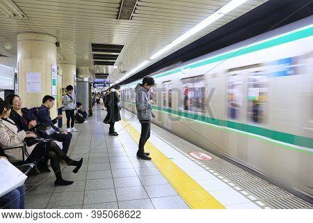 Tokyo, Japan - December 4, 2016: People Wait For Train Of Tokyo Metro. Toei Subway And Tokyo Metro H