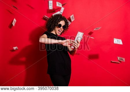Photo Portrait Of Crazy Girl Throwing Money In Air Isolated On Vivid Red Colored Background