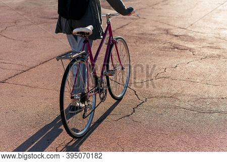 Unrecognizable Young Woman Walking With Her Retro Bike At Sunset, Concept Of Active Lifestyle And Su