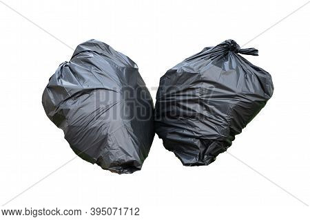 Black Plastic Trash Bin Bags Of Garbage Isolated On White Background With Clipping Path.