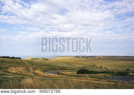 A Summer Country Road Runs Across Fields Of Chalk Grassland At Beachy Head On The Sussex Coast Of Th