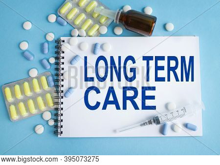 Long Term Care, Text On White Paper On Light Blue Background