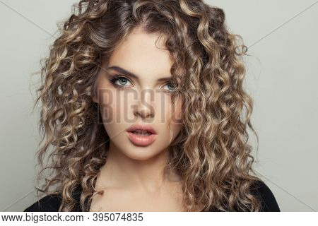 Beautiful Model Woman With Balayage And Curly Hair On White Background Portrait