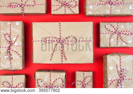 Many Craft Gift Boxes On Red Background. Christmas New Year Holiday Packaging Minimal Knolling Patte