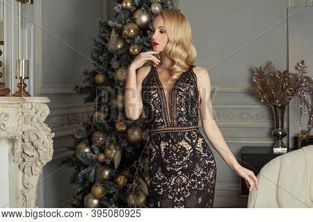 Christmas Woman Beautiful Fashion Model Posing Near Xmas Tree. Christmas Holiday And New Year Party