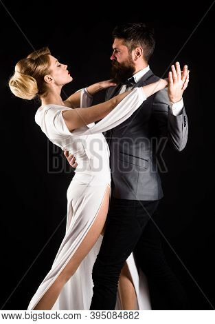 Couple Dancing Waltz. Passion And Love Concept. Dancing, Salsa, Tangoing. Couple In Tender Passion