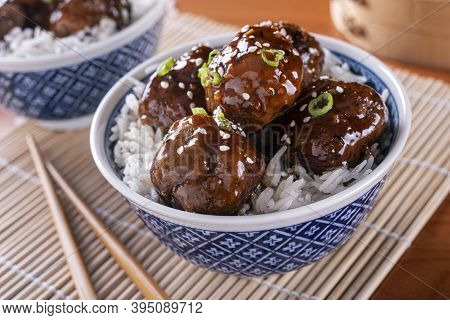 A Bowl Of Delicious Honey Garlic Meatballs With Steamed Rice.