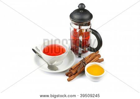 Cup of black tea from cowberry and mint with cinnamon sticks, and honey