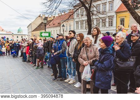 Budapest - March 15: People Watching A Performance On A Street In The Buda Castle On The Day Of The