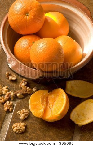 Bowl Of Oranges On Spanish Tile Floor