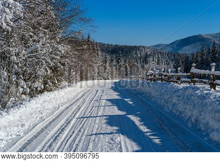Secondary Countryside Alpine Road To Remote Mountain Hamlet Through Snowy Fir Forest, Snow Drifts An